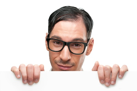 holding head: Smiling nerd holding a placard isolated on white background