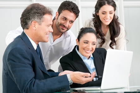 Happy business team discussing and working together at office meeting with laptop Stock Photo - 8590257