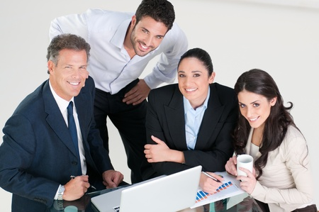 High angle view of smiling business team in office Stock Photo - 8590035