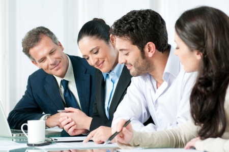 working together: Happy smiling business team working together in a modern office Stock Photo