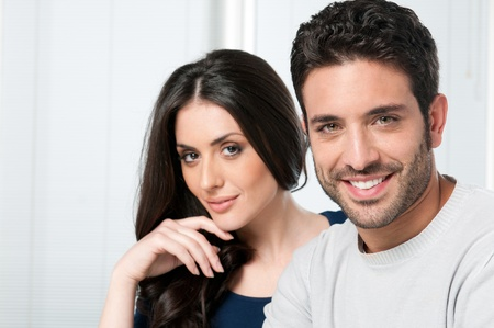 mid adult couples: Happy smiling couple looking together at camera Stock Photo
