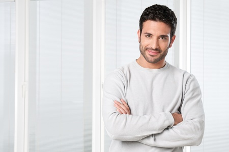 Handsome satisfied young man smiling and looking at camera Stock Photo - 8590019