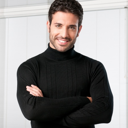 latin students: Happy smiling guy looking at camera with satisfaction Stock Photo