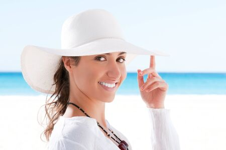 Happy beautiful young woman smiling and looking at camera at summer beach Stock Photo - 8857059