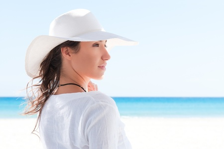 Beautiful girl looking away in a summer wonderful beach Stock Photo - 8857061