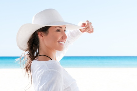 Beautiful girl relaxing and smiling outdoor at summer beach Stock Photo - 8857060