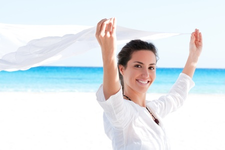 scarf beach: Beautiful young girl holding white fabric at wind in a summer vacation Stock Photo