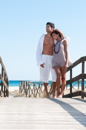 Young couple embracing together and relaxing at summer beach Stock Photo - 8857070