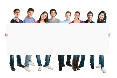 people holding sign: Happy smiling group of friends standing together in a row and displaying a white placard to write it on your own text, isolated on white background Stock Photo