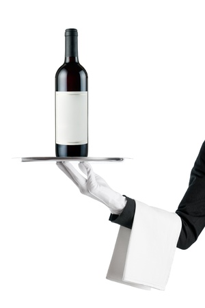 silver tray: Waiter serving a wine bottle with stainless tray isolated on white background