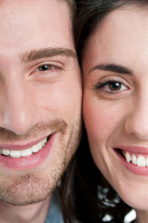 two and a half: Extreme closeup of smiling young couple faces Stock Photo