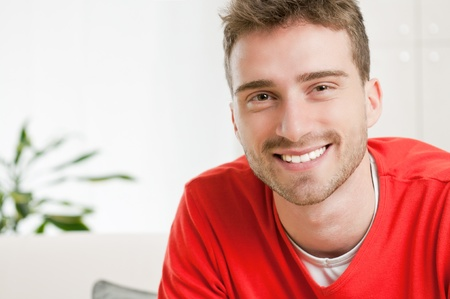 Happy smiling man looking at camera with satisfaction at home Stock Photo - 9677688