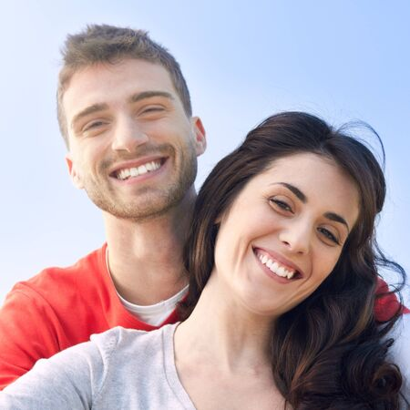 Happy smiling couple outdoor  photo