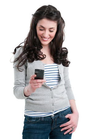 phone isolated: Beautiful smiling young woman holding a smart phone while text messaging isolated on white background