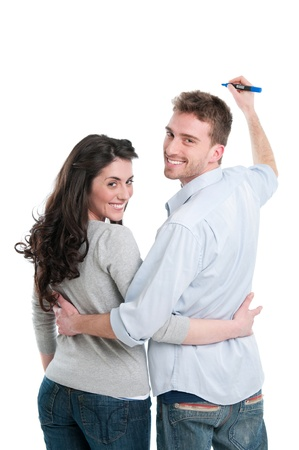 Smiling young couple writing with marker your own text isolated on white background photo