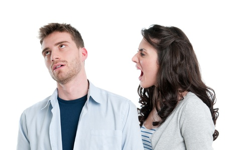 to argue: Young couple in conflict shouting isolated on white background