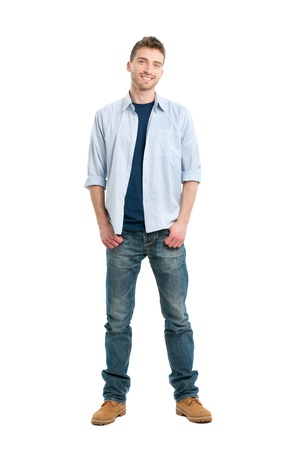 Happy smiling young man standing full length isolated on white background photo