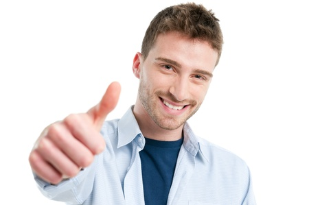 Happy smiling guy showing thumb up isolated on white background photo