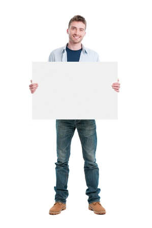 Smiling young casual man holding white sign to write it on your text isolated on white background Stock Photo - 9677544