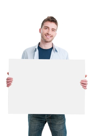 holding a sign: Smiling young guy holding white poster to write it on your own text