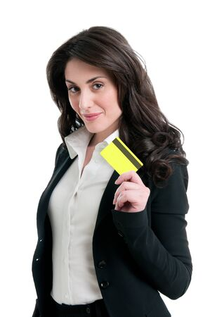 Happy satisfied business woman holding and showing her credit card isolated on white background photo