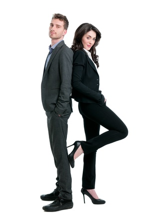 Proud successful business couple looking at camera isolated on white background photo