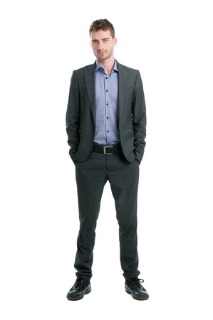 Confident young businessman looking at camera isolated on white background photo
