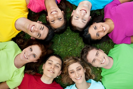 Happy smiling group of young friends staying together outdoor in the park Stock Photo - 9765613