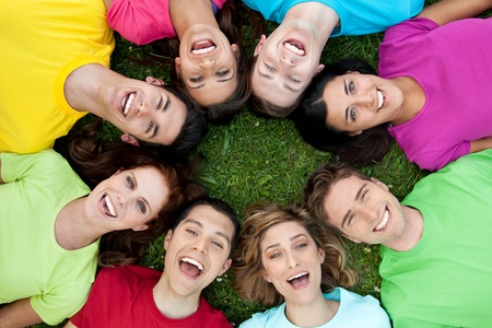 Happy joyful group of young friends enjoy together the life outdoor photo