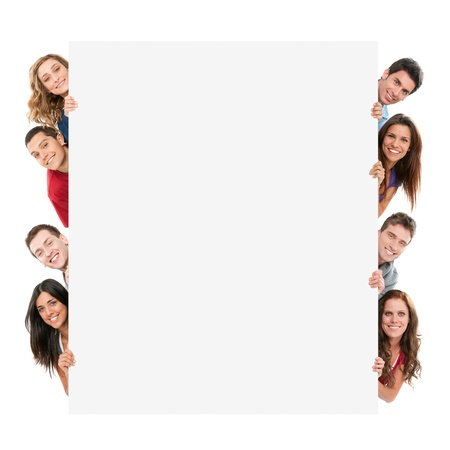 Happy smiling group of friends showing blank placard board to write it on your own text isolated on white background photo