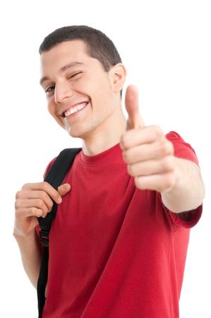 estudiantes universitarios: Sonriente joven estudiante exitoso mostrando el pulgar hasta aislada sobre fondo blanco