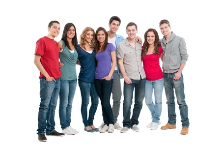 group of teens: Happy smiling young group of friends standing together isolated on white background