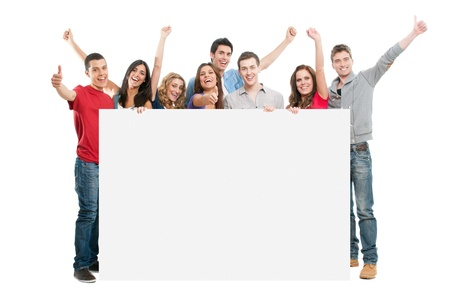 exhibiting: Happy joyful large group of friends diplaying white placard for your text isolated on white background Stock Photo