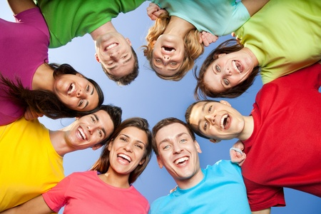 staying: Happy joyful group of frined staying together outdoor
