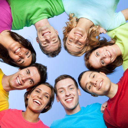 young people group: Happy joyful friends forming a circle of head