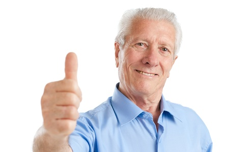 Happy satisfied senior aged man showing thumb up isolated on white background photo