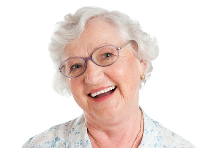 Happy smiling senior lady looking at camera with her glasses isolated on white background Stock Photo - 10562920