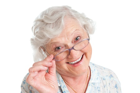 Happy smiling retired lady wearing her new pair of glasses isolated on white background