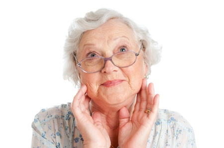 Happy surprised senior lady looking up isolated on white background Stock Photo