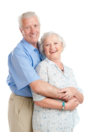 Happy smiling senior couple standing together with an embrace isolated on white background photo