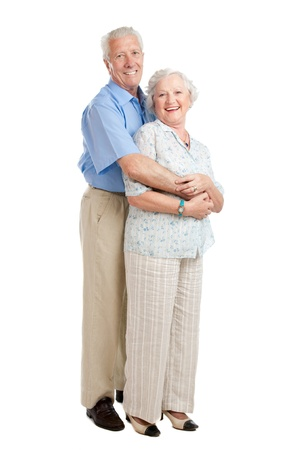 Satisfied smiling senior couple standing full length together isolated on white background Stock Photo - 10562917