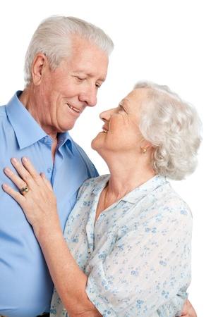 happy couple white background: Happy loving senior couple embracing together isolated on white background Stock Photo