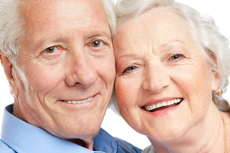 Smiling satisfied senior couple looking together at camera closeup photo