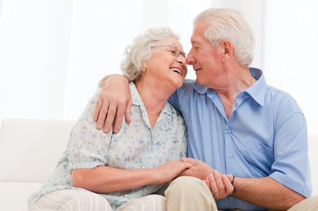 Happy joyful aged couple loving and enjoy the retirement at home photo