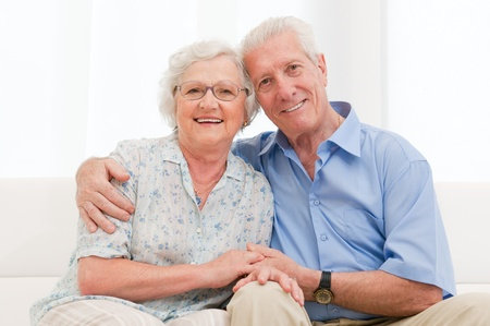 seniors homes: Happy smiling senior couple embracing together at home