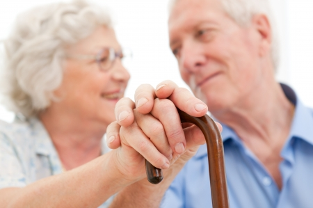 Serene aged husband and wife supporting and staying together during the old age photo