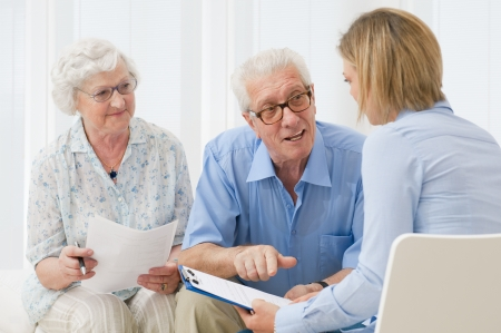 financial advice: Business agent planning with a retired couple their future investments