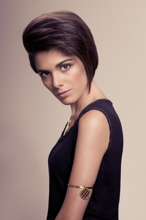 Beautiful fashion woman with straight short hairstyle posing photo
