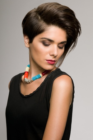 Beautiful fashion woman with straight short hairstyle photo