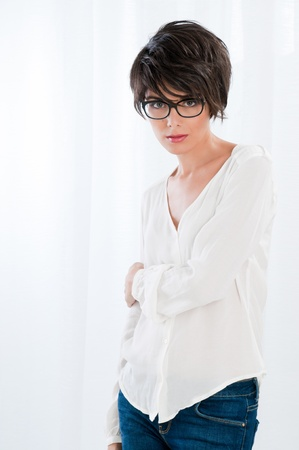 Natural beautiful woman with glasses standing in bright light Stock Photo - 11119842
